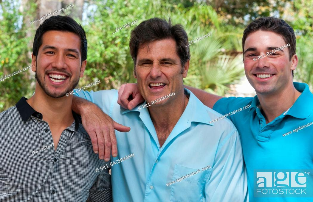 Stock Photo: Male buddies friends in park portrait aged 30s and 40s in sunshine.