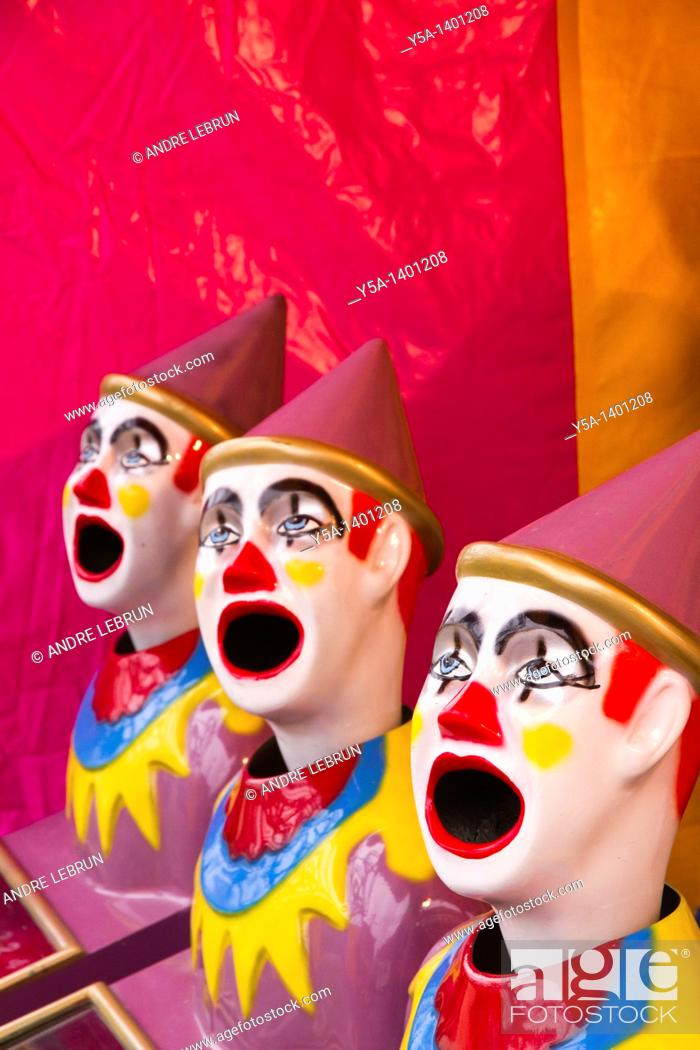 Stock Photo: Laughing clowns amusement in sideshow alley.