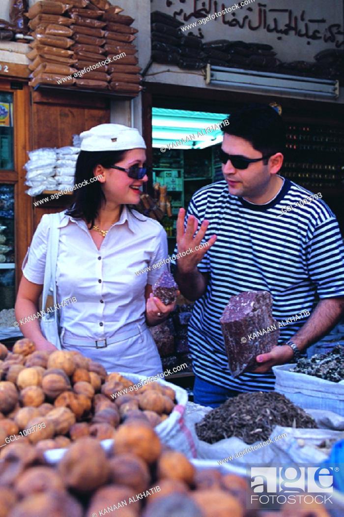 Stock Photo: Western tourists on the spice market in Dubai, United Arab Emirates.