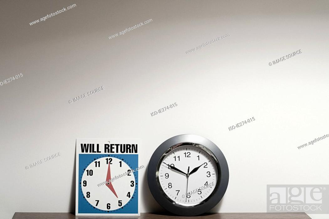Stock Photo: Sign and clock.