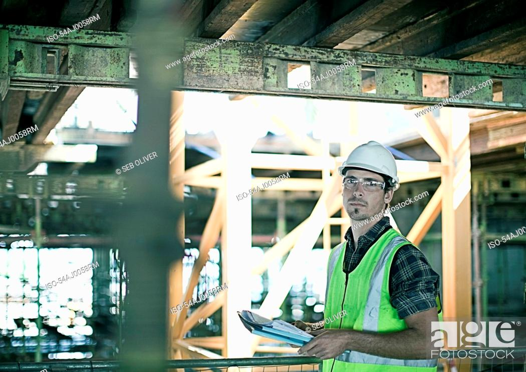 Stock Photo: Construction worker walking on site.