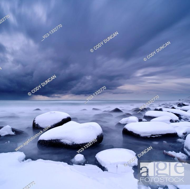 Stock Photo: Winter storm over snow covered beach, Unstad, Lofoten islands, Norway.