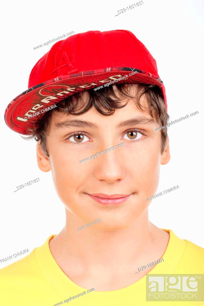 Stock Photo: portrait of a teenage boy in red baseball cap -isolated on white.