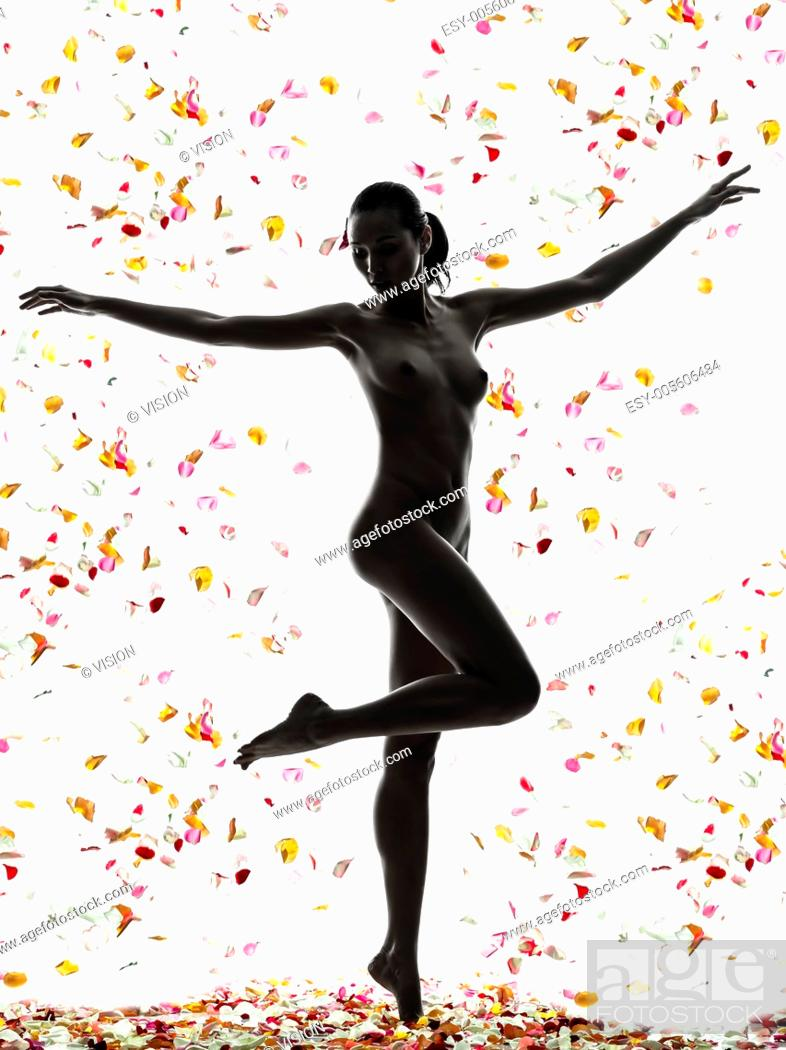 Stock Photo: one beautiful asian woman naked with petal flowers in silhouette studio isolated on white background.