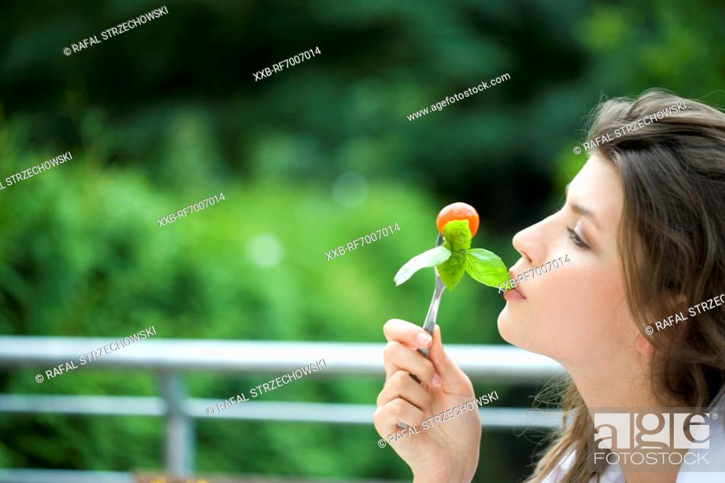 Stock Photo: Woman with fork.