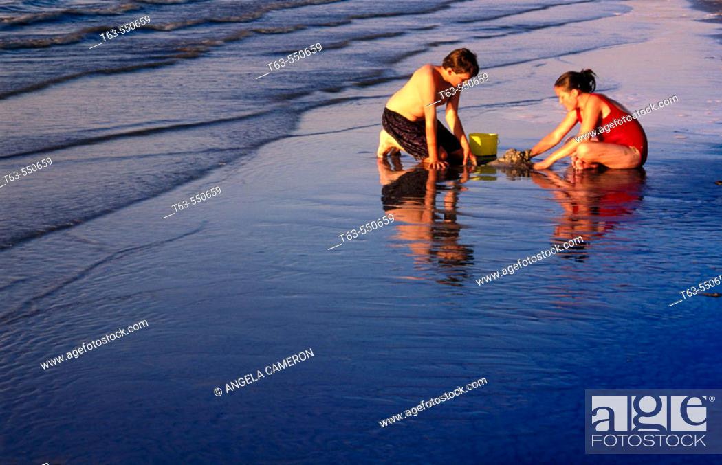 Stock Photo: Children playing  on the beach.