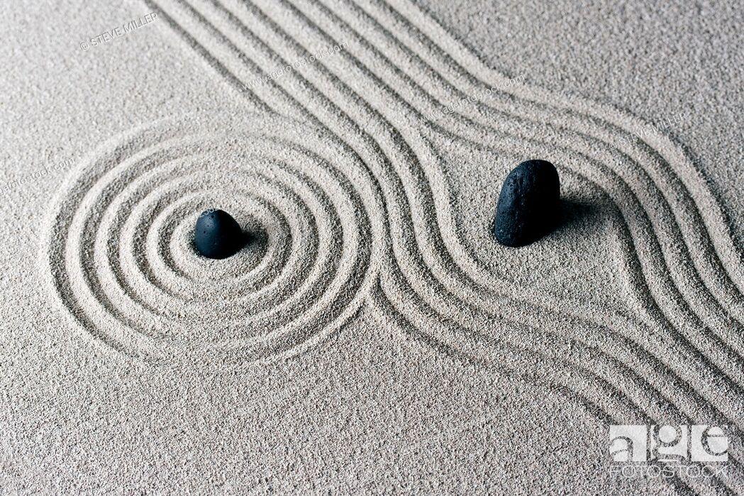 Stock Photo: raked sand - zen rock garden - japan zen spirit inspired arrangement.