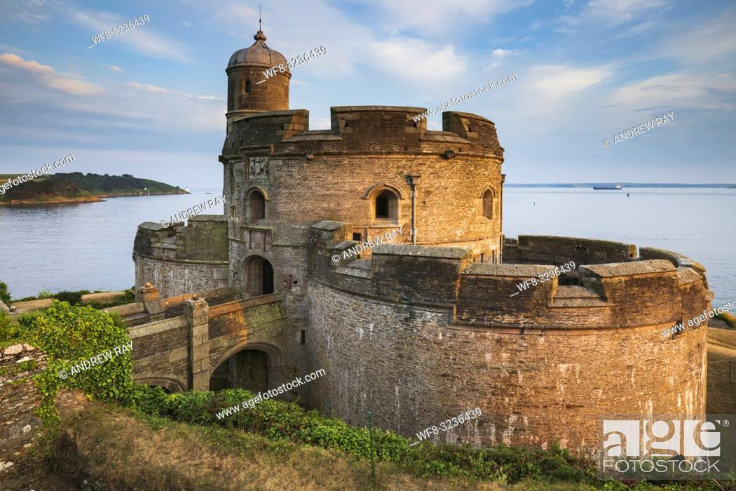 Stock Photo: St Mawes Castle on Cornwall's Roseland Peninsula illuminated by late evening sunlight in late June with the lighthouse on St Anthony Head in the distance.