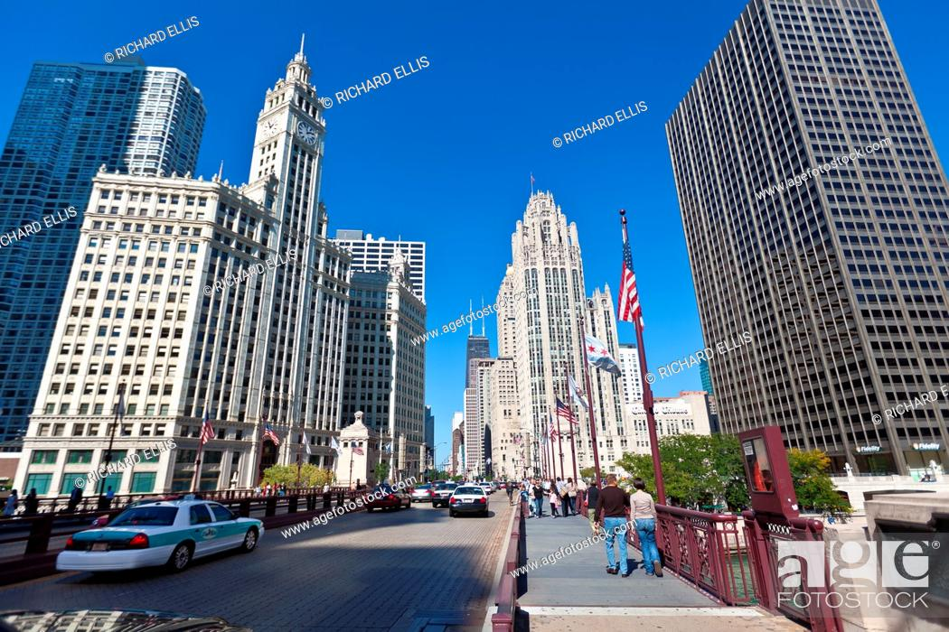 Stock Photo: View along N Michigan Ave Bridge showing the Tribune Tower and Wrigley Building in Chicago, IL, USA.