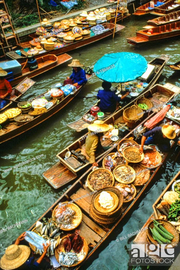 Stock Photo: Color graphic image of shopping boats at the famous Floating Market at Damnernsaduak near Bangkok Thailand.