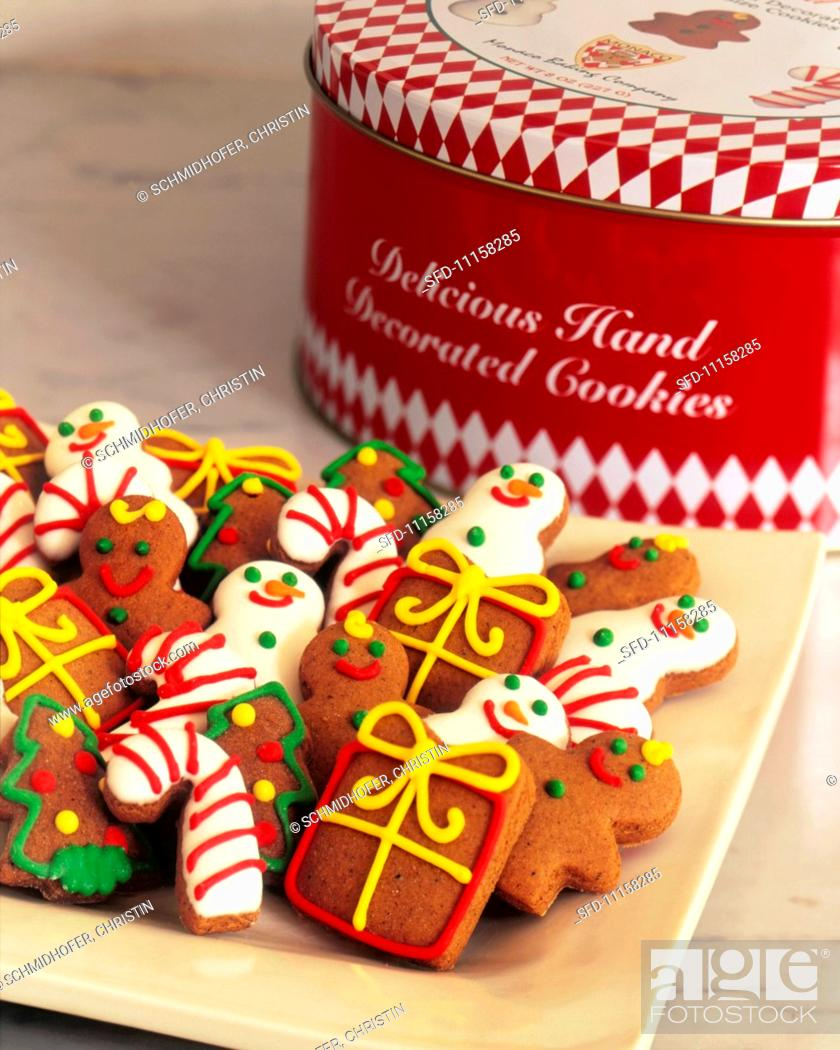 Assorted Decorated Christmas Cookies On A Platter With Cookie Tin In