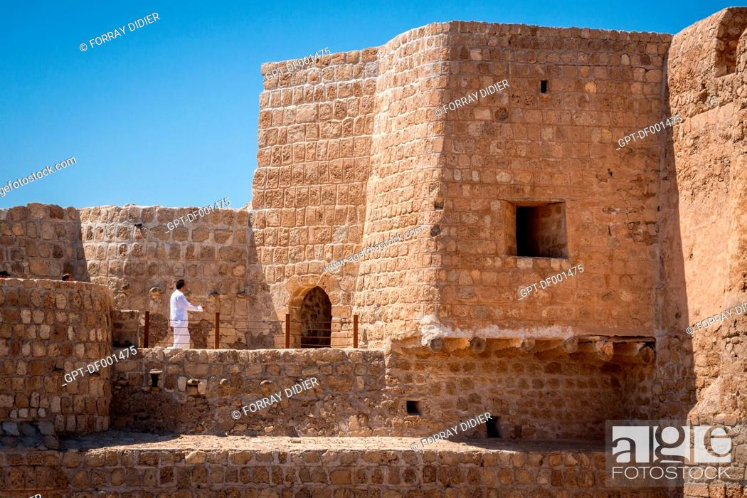 LOCAL VISITORS STROLLING IN THE BAHRAIN FORT QAL'AT AL