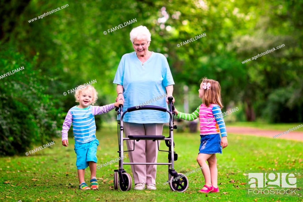Hy Senior Lady With A Walker Holding