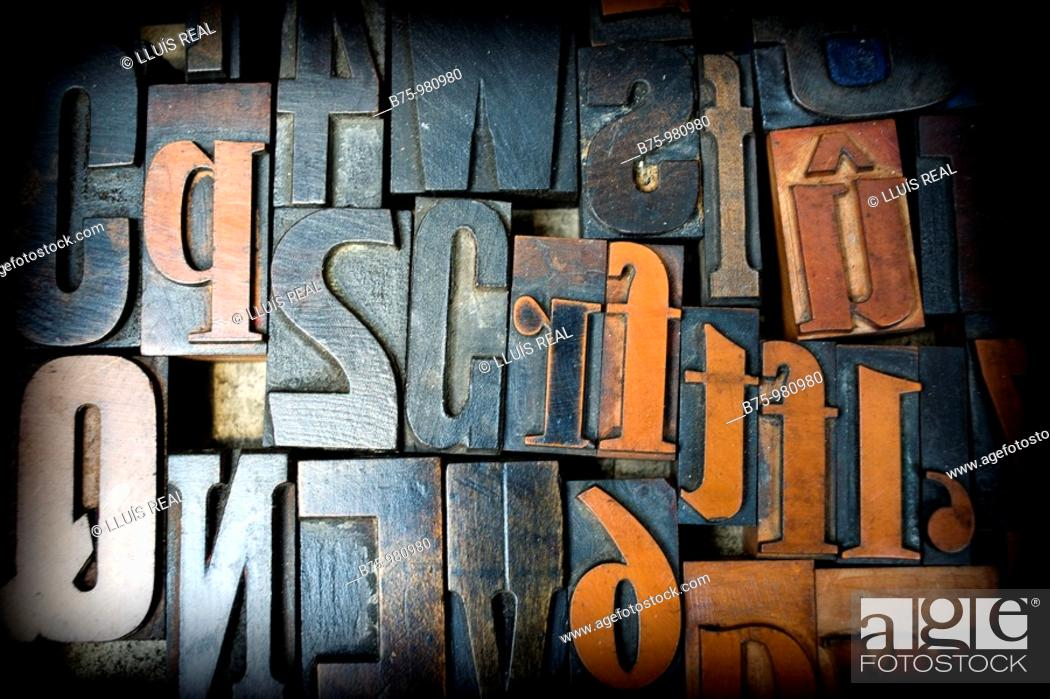 Stock Photo: A pile of vintage wooden letters tiphography.