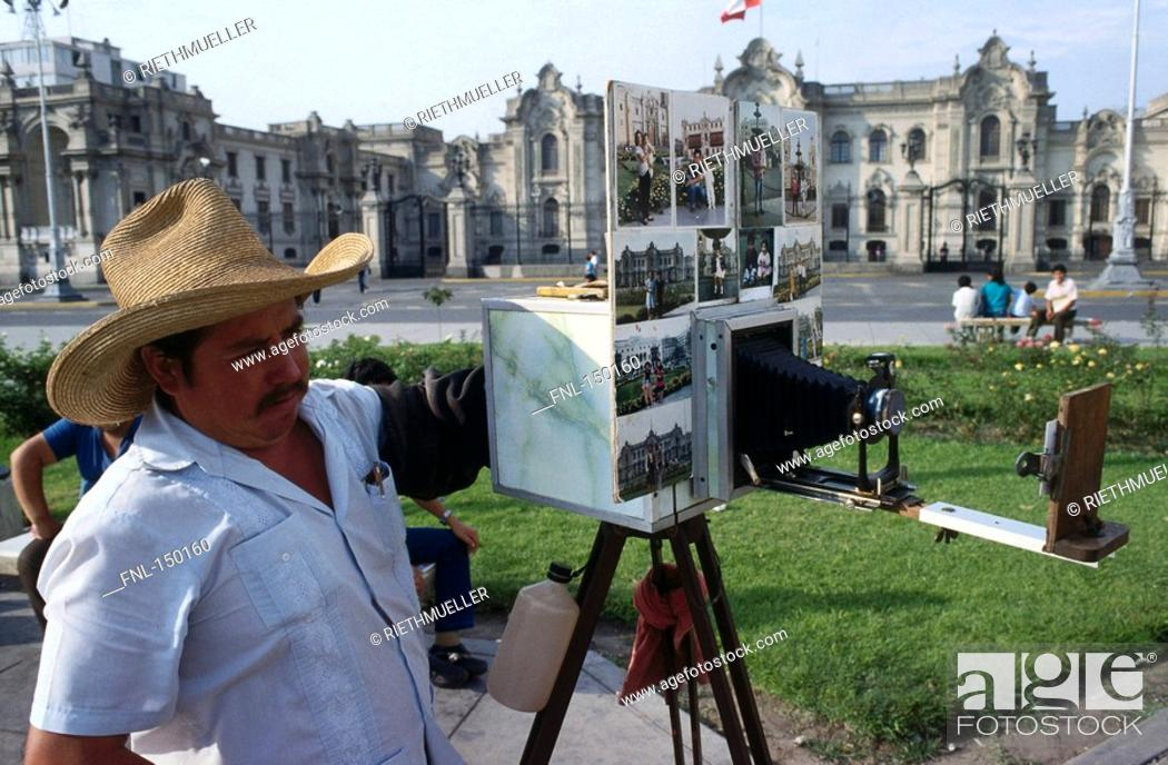 Stock Photo: Photographer taking picture with old camera, Plaza Mayor, Lima, Peru.