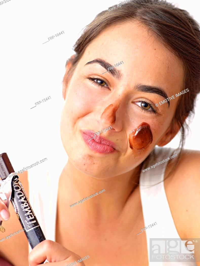 Stock Photo: Brunette woman with a chocolate mask.