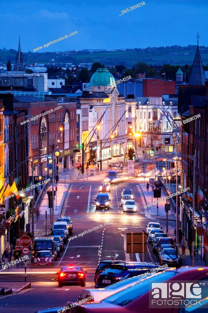 Stock Photo: Ireland, County Cork, Cork City, elevated city view from St. Patrick's Street, dusk.