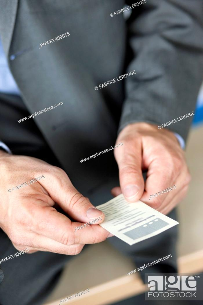 Stock Photo: Close-up of a businessman holding a business card.
