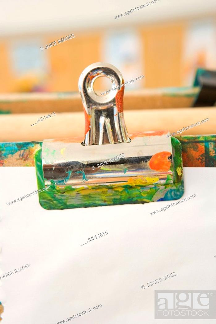 Stock Photo: Bulldog clip holding paper on easel.