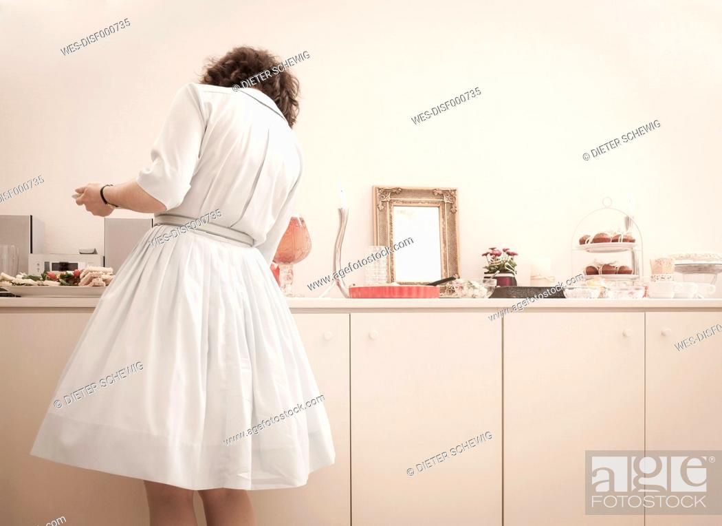 Stock Photo: Young woman at the buffet on a retro style tea party.