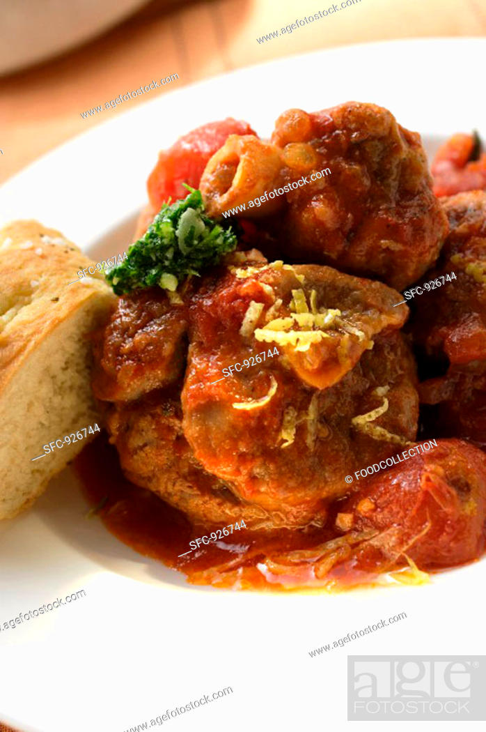Stock Photo: Osso buco with tomatoes and focaccia.