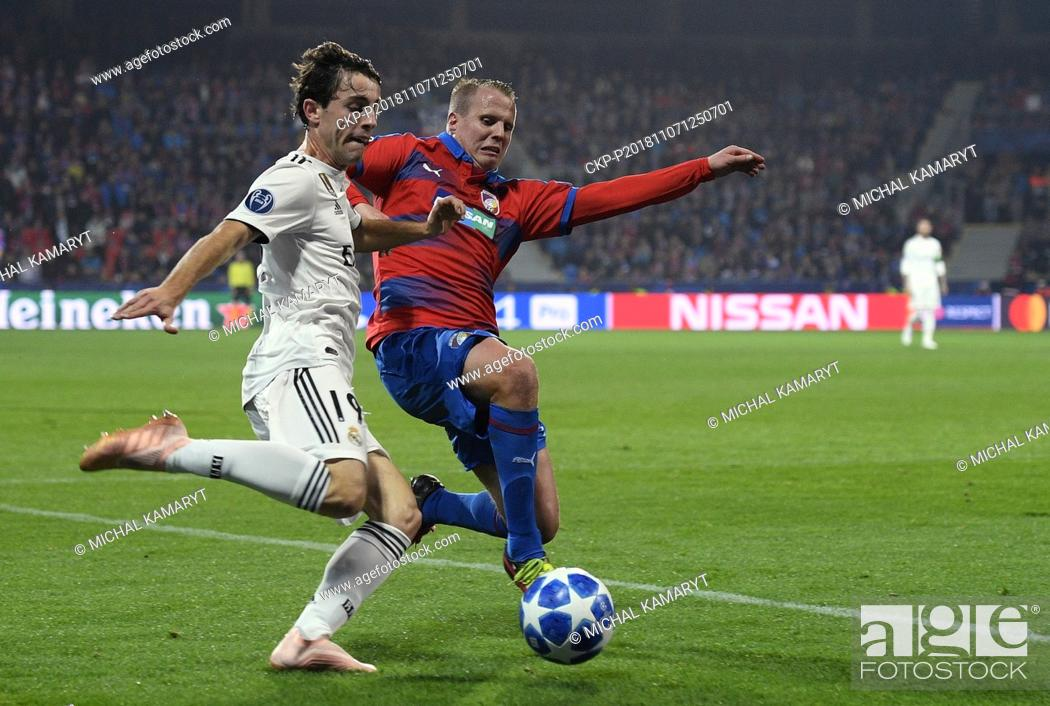 Stock Photo: L-R ALVARO ODRIOZOLA (Madrid) and DAVID LIMBERSKY (Plzen) in action during the UEFA Champions League match, group stage, group G.