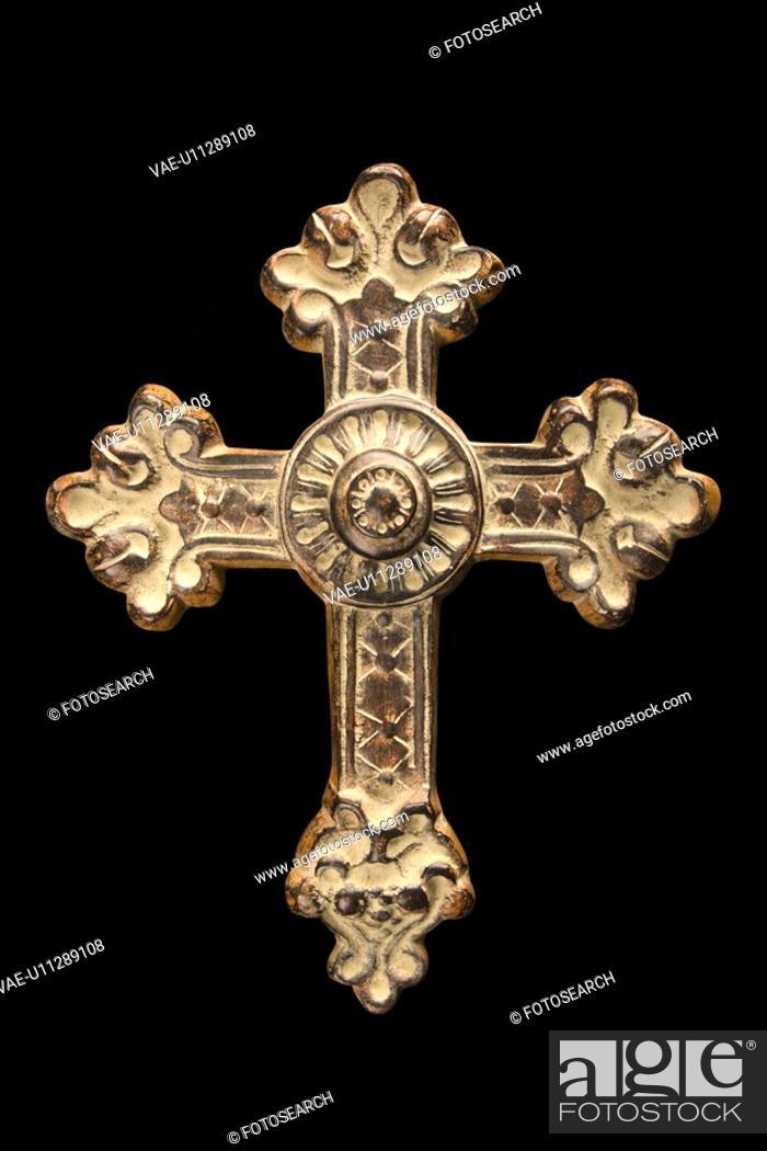 Stock Photo: Ornamental religious cross against black background.