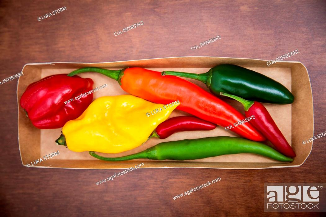 Stock Photo: Overhead view of various chillies in box.