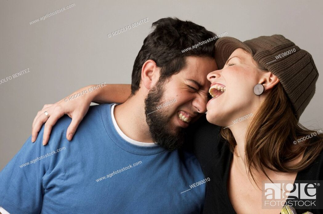 Stock Photo: Young trendy couple smiling.