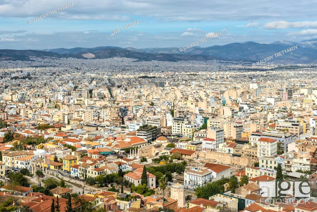 Stock Photo: View of Athens from Acropolis with mass of houses, buildings, apartments, rooftops in the city of Greek capital, Greece.