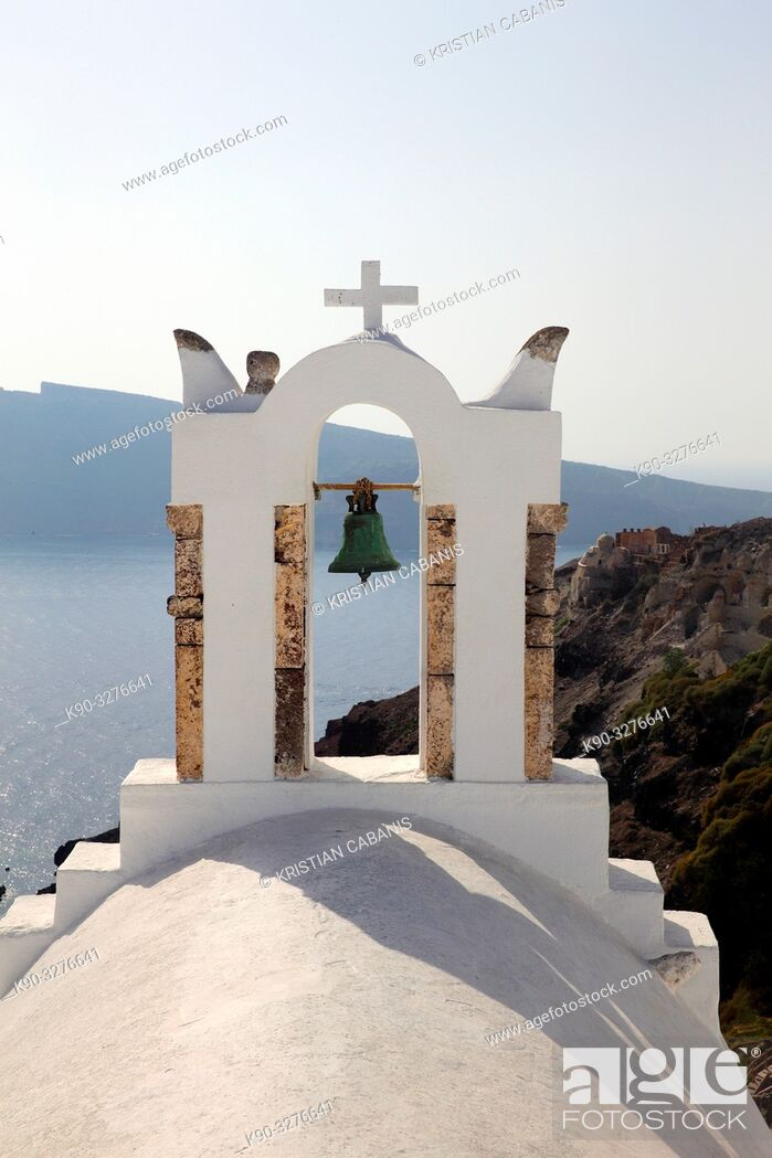 Stock Photo: Belltower of a church in Oia with view into the caldera, Santorin, Greece, Europe.