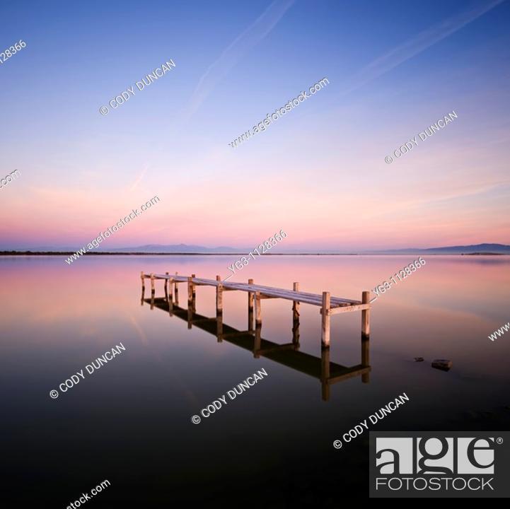 Stock Photo: Abandoned walkay in water, Salton Sea, California.