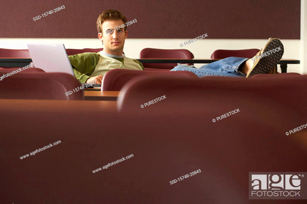 Stock Photo: Portrait of a college student sitting in a lecture hall.