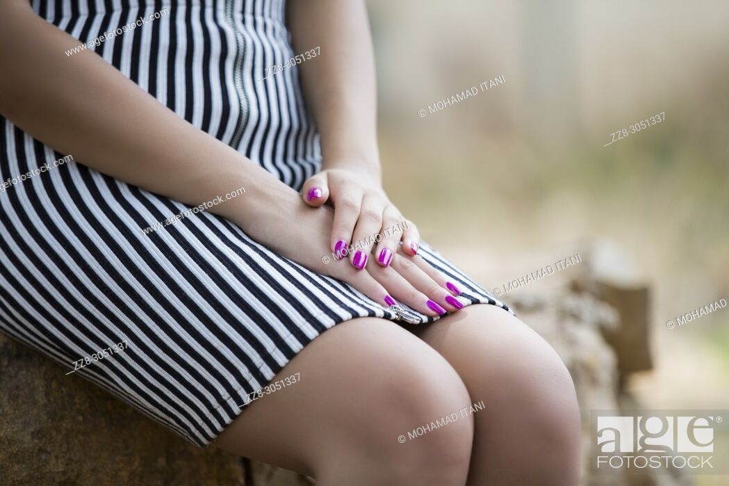 Stock Photo: Close up of a young woman's hands.