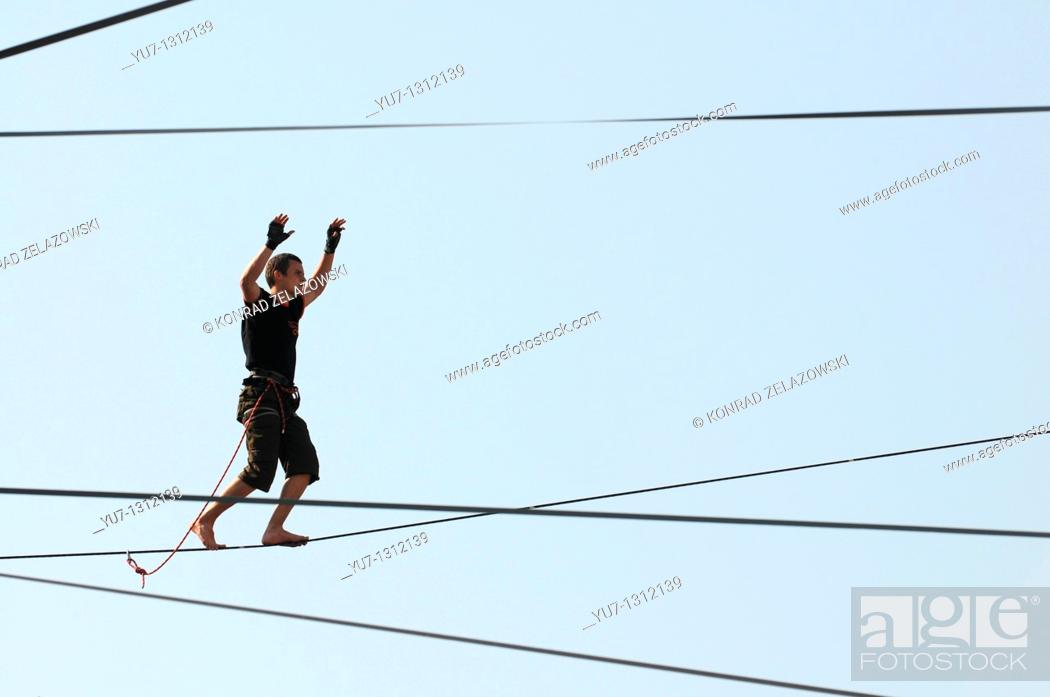 Stock Photo: Polish slackliner Damian Czermak during show in Warsaw, Poland.