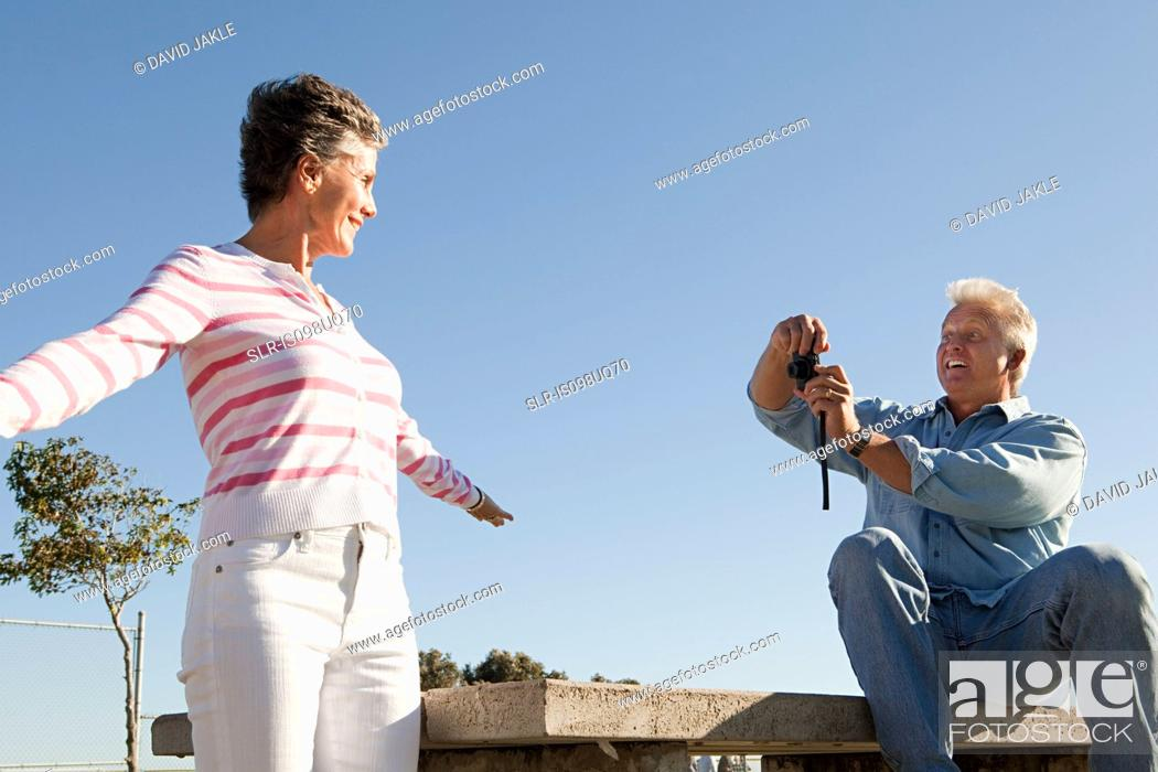 Stock Photo: Man photographing woman.