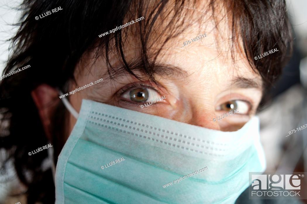 Stock Photo: Woman wearing mask.