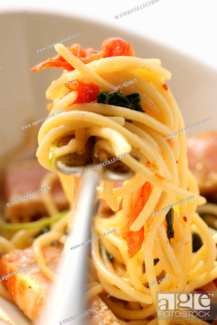 Stock Photo: Spaghetti with tuna, tomatoes and basil on fork.