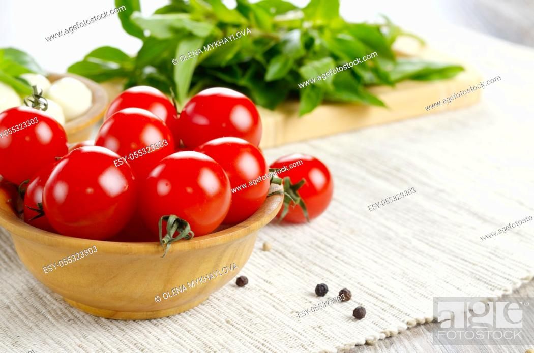 Stock Photo: Mozzarella cheese, cherry tomatoes, basil leaves and olive oil - for caprese salad.