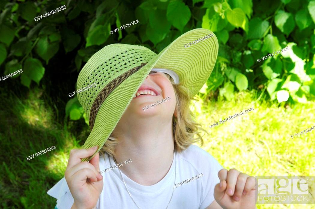 Stock Photo: The little girl in hat.