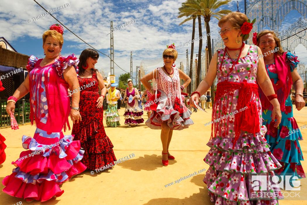 Stock Photo: Women wearing beautifully coloured gypsy dresses at the Feria del Caballo (Horse Fair) in Jerez de la Frontera. Cádiz province, Andalusia, Spain.