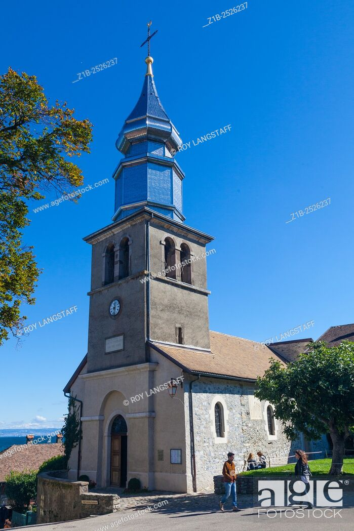 Stock Photo: The church of Yvoire with its polished metal spire, Haute Savoie, France.