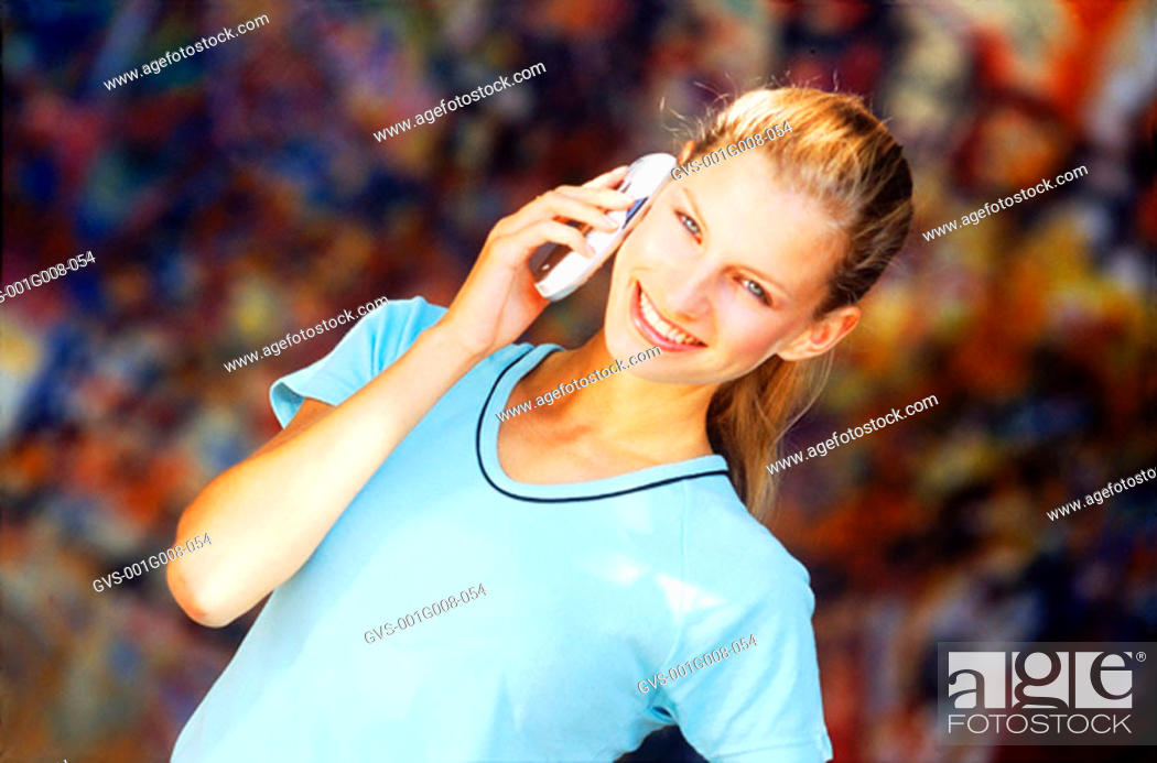 Stock Photo: Young women talking on a mobile phone.