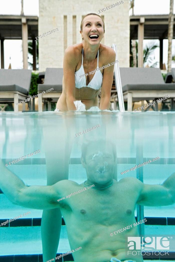 Stock Photo: View of a couple underwater in a swimming pool.