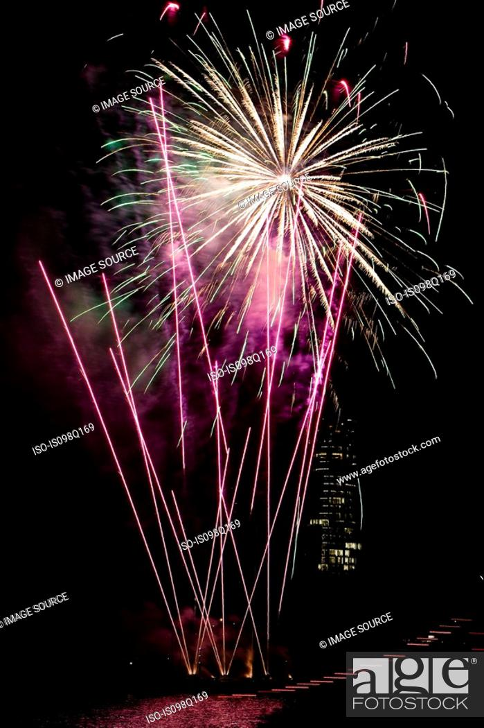 Stock Photo: Firework display over a river.