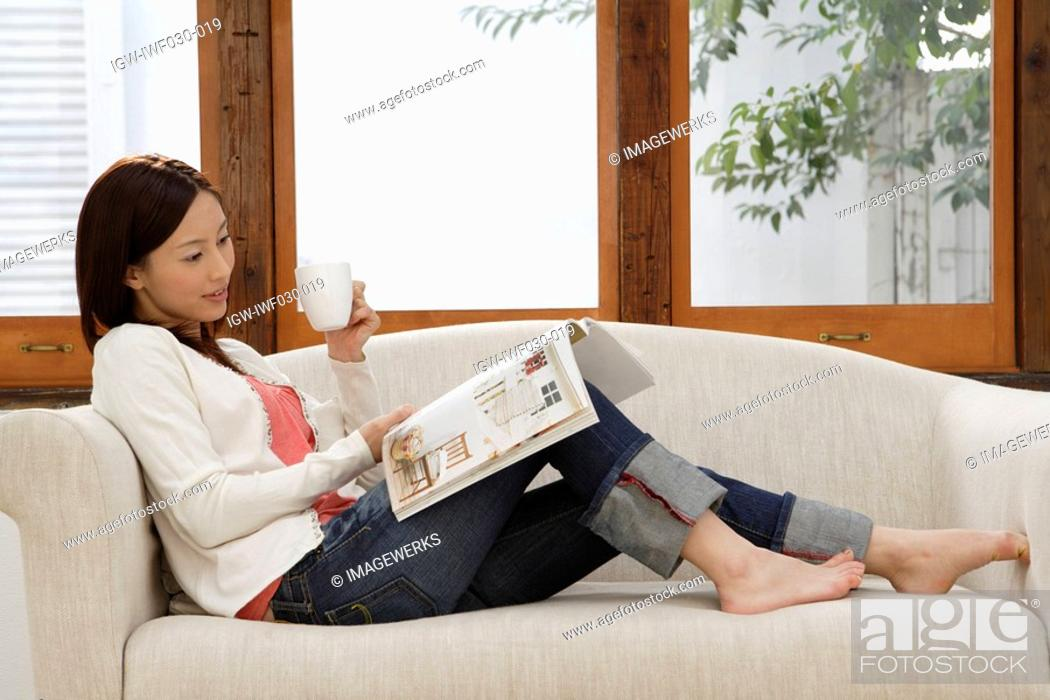 Stock Photo: View of a woman reading a magazine.