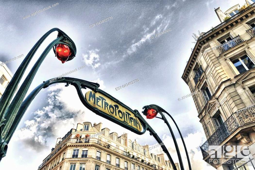 Stock Photo: PARIS - NOV 29: Beautiful metro sign outside a station, November 29, 2012 in Paris. Subway system server more than 4 million passengers a day.