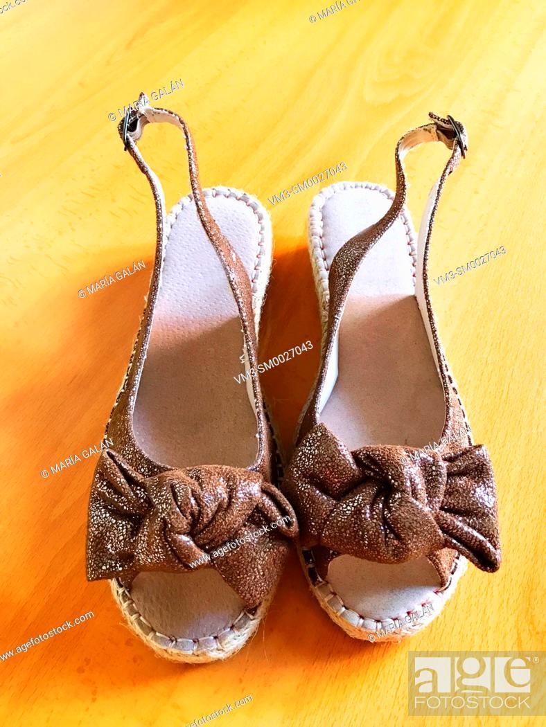 Stock Photo: Golden sandals.