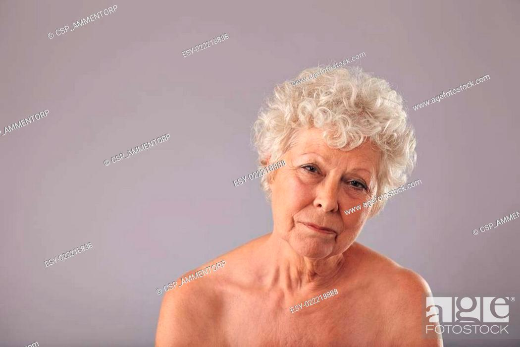 Stock Photo: Shirtless old lady looking sad.