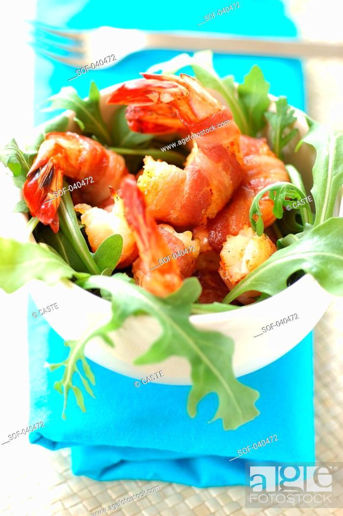 Stock Photo: Roast Mediterranean prawns, smoked bacon and rocket lettuce.